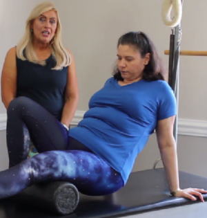 Sabrina Vaz and Dr. Jessica Pizano using a roller to do lower body exercises