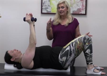 Sabrina Vaz and Dr. Jessica Pizano doing a mat workout